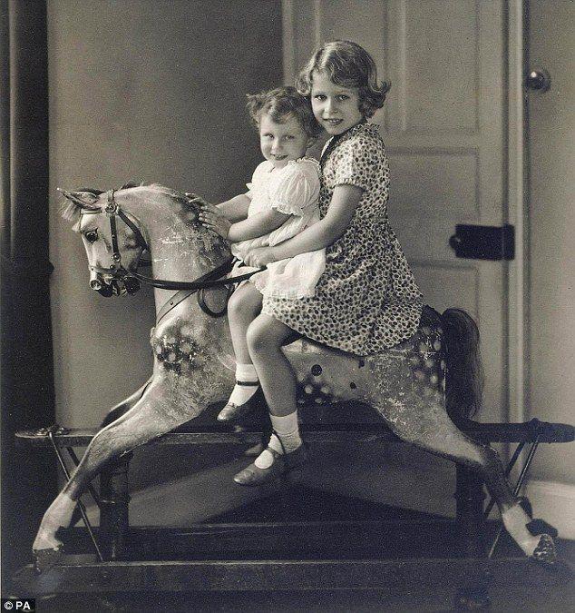 Playful princesses: Princess Elizabeth and Princess Margaret riding a rocking horse at St. Paul's Waldenbury in August 1932