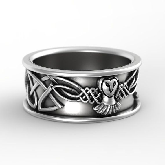 A truly unique ring design that you wont see anywhere else! An intricate design of a mystical owl in flight, gracefully woven into a flowing pattern of Dara knotwork that circles the entire band. Merging the classic iconographic owl in flight with the traditional Irish art of Celtic knotwork, these bands are the synergy of two distinct but similar spiritual energies, like the love that the two of you share. Perfect for the lover symbolic mysticism entwined with graceful beauty! Each ring is…