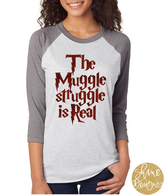 The Muggle Struggle is Real - Harry Potter Glitter Shirt You will love our Harry Potter Glitter Shirt! This all glitter design comes on a heather white/ grey sleeve baseball shirt. Shirt is in unisex sizing so can run loose on most. We would love for you to share your pictures