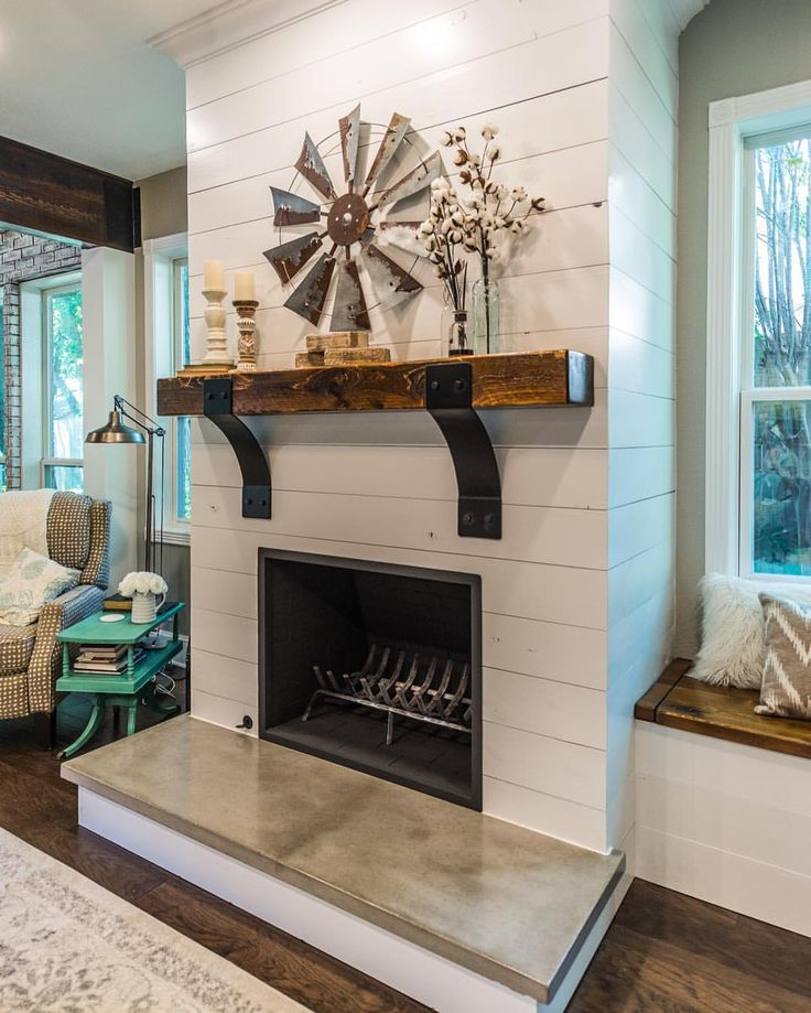 We've got one more fireplace throwback to wrap up your week! This project was only a few months ago, but it was one of our favorites! The Honey House - shiplap, concrete hearth cap, and cedar mantle with custom metal corbels. The talented @thomasandlane collaborated on the decor on this project. You can find the Before & Afters on all three fireplaces from this week on our site - irwinbuilds.com - under Gallery & Blog! Photo courtesy of @darbykatephoto
