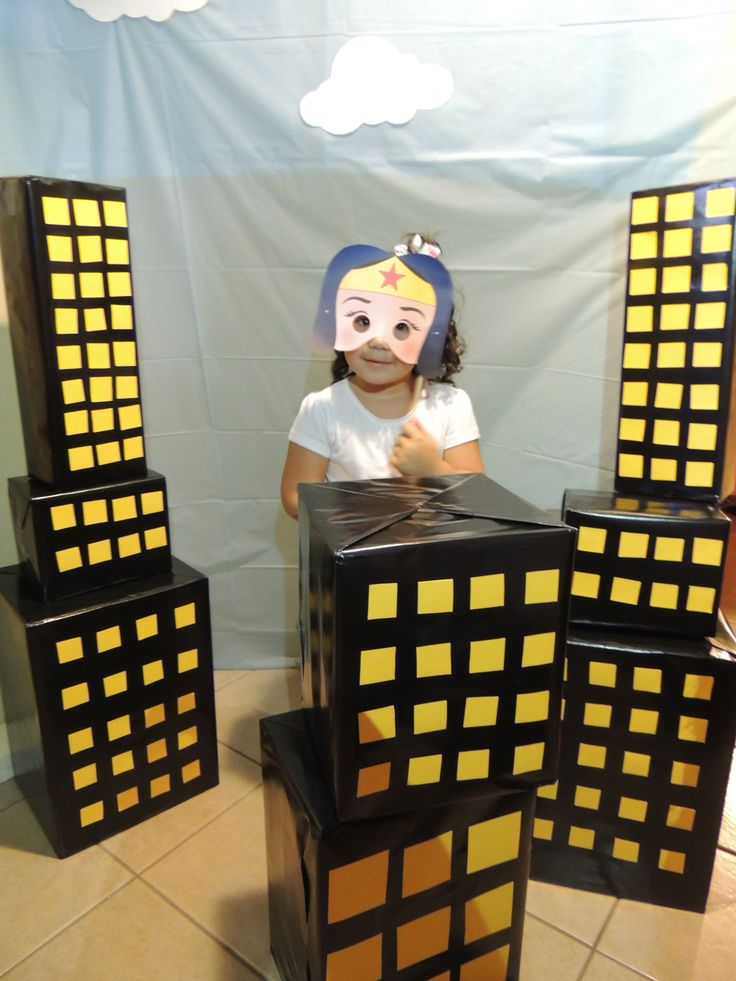 Boxes wrapped in black or painted with yellow windows great 3d decoration and can we another photo prop