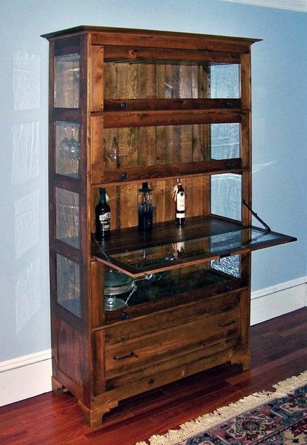 : Striking Wooden Glass Liquor Cabinet With Wine Drinks Insie It Installed In Traditional Basement On Wood Glossy Floor
