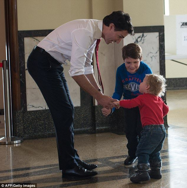 Essay: Trudeau (pictured with Hadrien and Xavier) went on to define feminism as 'the knowledge that when we are all equal, all of us are more free'