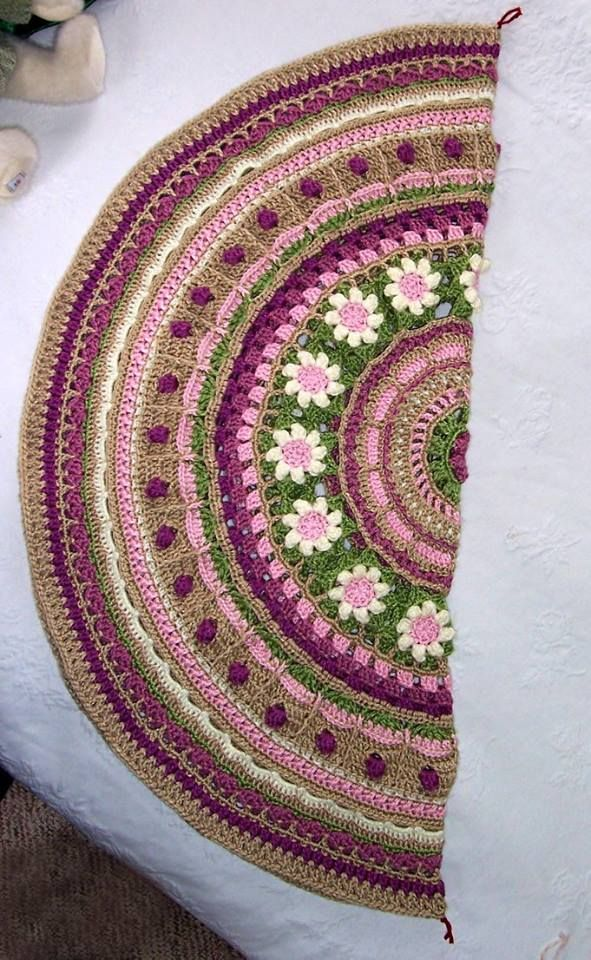 I folded the mandala and put stitch markers on the fold for the first two corners.