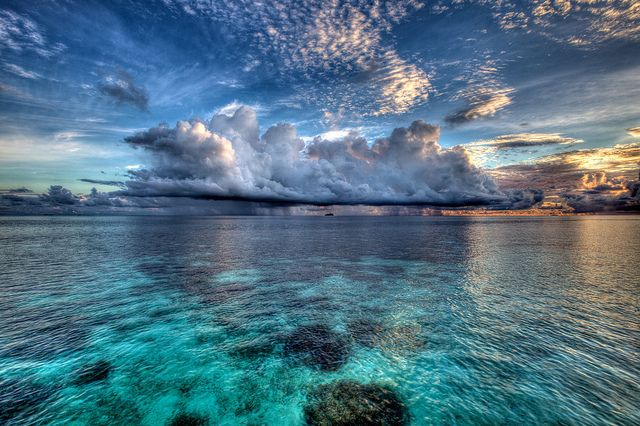 the maldives! This looks awesome. Ocean .beach. blue. Wonders. Clouds sky horizon