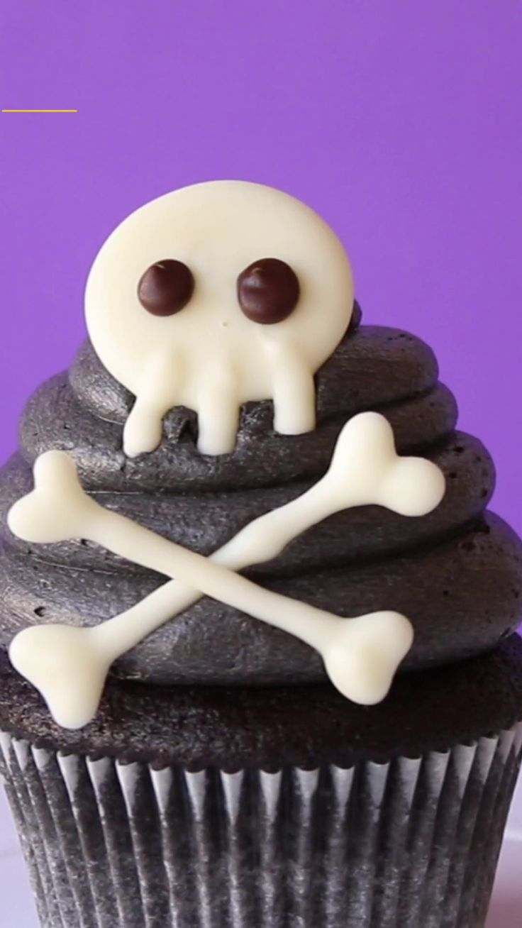 Recipe with video instructions: Make a statement this Halloween with these scaryily cute Skull Cupcakes. Ingredients: 50g cocoa powder, 175g plain flour, 2 large eggs, at room temperature, 1 tsp vanilla extract, ½ tsp salt, ½ tsp bicarbonate of soda, 225g caster sugar, 175g unsalted butter, softened, 175ml milk, 1 batch of vanilla buttercream frosting, 3tbsp cocoa powder (unsweetened), 1tbsp black food gel colour (americolour 'SUPER BLACK') for batter, 1tbsp black food gel colour…
