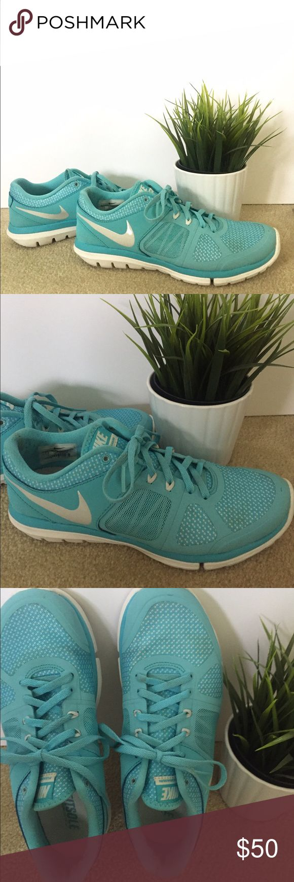 Tiffany blue Nike flex run size 7.5 Tiffany blue and white Nike flex run 2014 size 7.5 worn a handful of times but some light staining throughout hardly noticeable when worn very cute pair for working out or to wear casually got a lot of compliments on these Nike Shoes Athletic Shoes