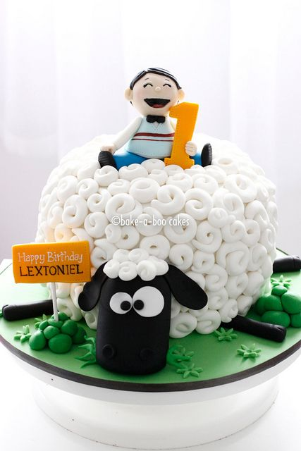 A sheep and a boy cake by Bake-a-boo Cakes NZ, via Flickr. This cake is super cute.  Grandma Alice and Grandpa Dan have sheep at their house. .. maybe I should try it