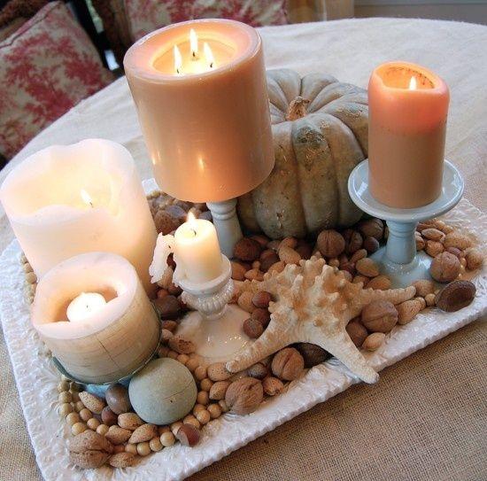 Coastal Fall: unexpected mixture of candles, seashells, and hmmm a white pumpkin :) I like.