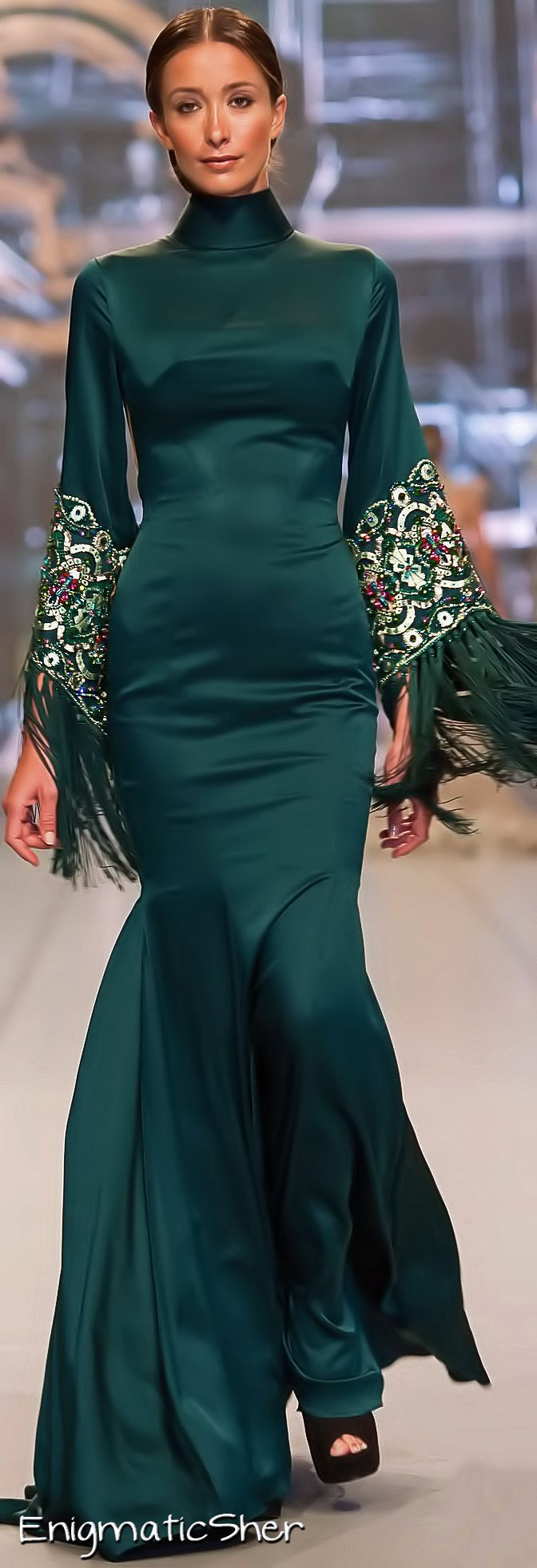 Ezra Couture FW-13/14: Spanish inspired green gown with embroidered sleeves & fringes.