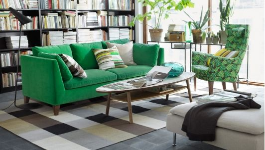 Green sofa in a natural-feeling living room