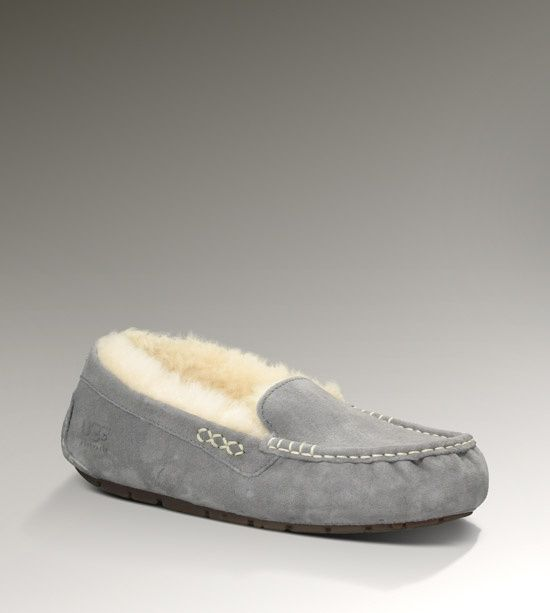 Women's gray Ugg slippers . . . fashionable and comfortable. Made of water-resistant suede and rubber soles -  can be worn indoors or outdoors.