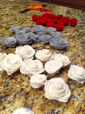 DIY Felt Flowers -- To get a more realistic looking flower with non-uniform petals, you should cut out your felt (spirals) in a wavy pattern.
