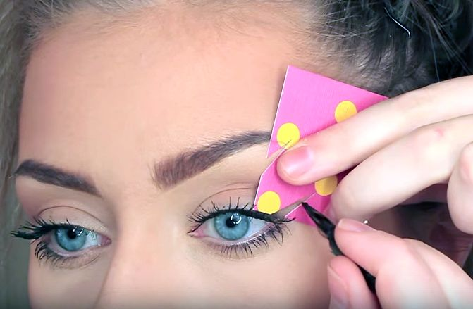 We love this trick! Cut out your desired cat-eye shape from an old greeting card. Then hold it against your eye and color it in. That's it -- simple as pie! This will work with any kind of cardstock.  Visit Danielle Mansutti's YouTube channel forthis Eyeliner Stencil Hack tutori