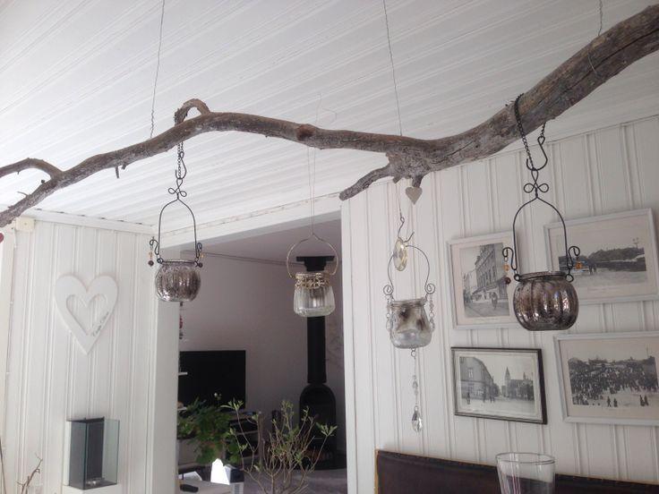 Gren i taket med ljushållare