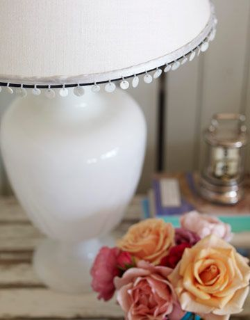 Shells fringe a custom shade on a Pottery Barn lamp in the master bedroom. - HouseBeautiful.com