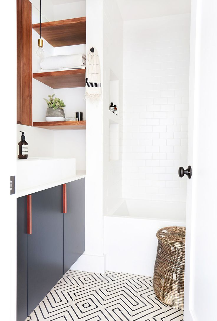 Bathroom master. Black cabinets. White walls. Tile art. Home+Tour:+A+Hip+Couple's+Fresh+California+Bungalow+via+@MyDomaine