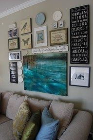 Create a well put together wall grouping even if you arent an art collector! Use various family photos, printed quotes, plates or whatever fun things you have collected and hang them on your wall!