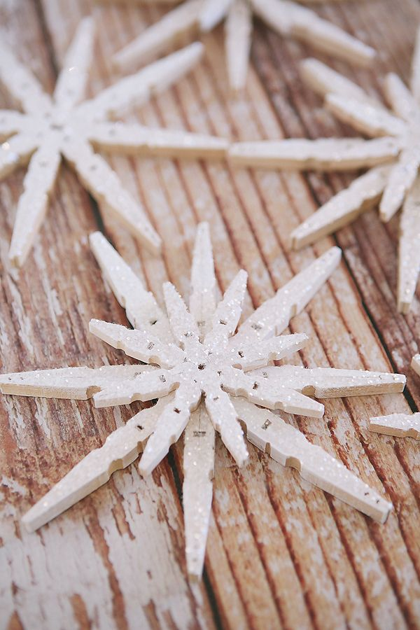 Glittered Clothespin Snowflakes | Use regular clothespins to make these pretty snowflakes!