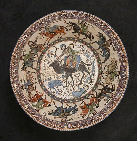 Bahram Gur and Azada    Object Name:      Bowl  Date:      12th–13th century  Geography:      Iran  Medium:      Stonepaste; polychrome in-glaze and overglaze painted on an opaque monochrome glaze (mina'i)  Dimensions:      3 13/16 x 8 1/2 in. (9.7 x 21.6 cm)  Classification:      Ceramics