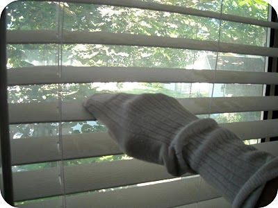 A simple way to clean blinds ~ use an old odd sock... Mix equal parts vinegar and warm water