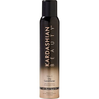 :  Spray the Dry conditioner on the palm of your hands and smooth over the side and top to tame any fly aways.Kardashian BeautyTake 2 Dry Conditioner