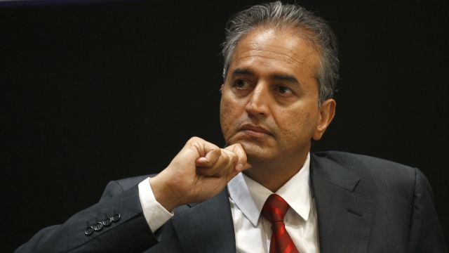 Chairman of Narayana Hrudayalaya Hospitals Devi Shetty listens to President and Chief Executive Officer Ascension Health Alliance Anthony Tersigni, not seen, during a press conference in Bangalore, India, Wednesday, Aug. 8, 2012.