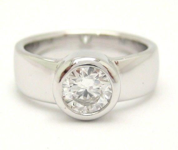 Reminds me of my favorite, the Tiffany Etoile engagement ring, but cheaper by 9 grand.