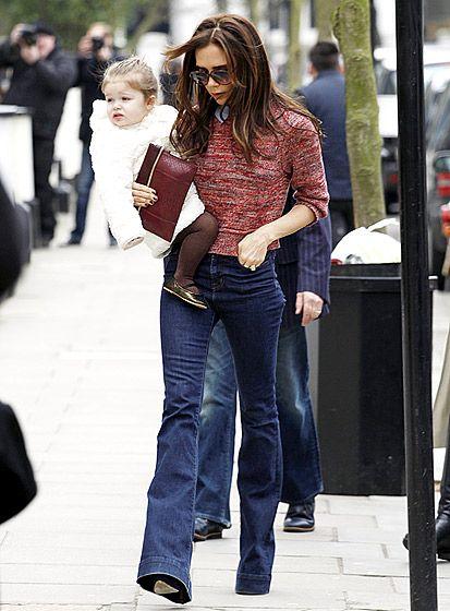 Victoria Beckham carried her daughter Harper through Londons Notting Hill neighborhood March 26.