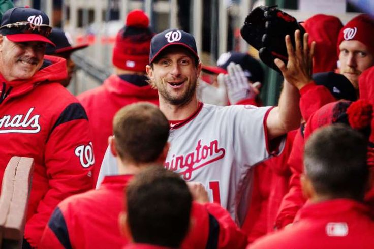 SO FAR SO GOOD:    Washington Nationals starting pitcher Max Scherzer (31) celebrates in the dugout after after teammates after being relieved in the seventh inning against the Philadelphia Phillies at Citizens Bank Park. The Nationals won 7-6 on April 7.
