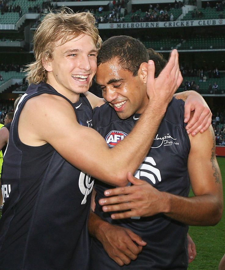 Dennis celebrating with Chris Yarran after Carlton wins the 2009 Round 8 match against Collingwood at the MCG.