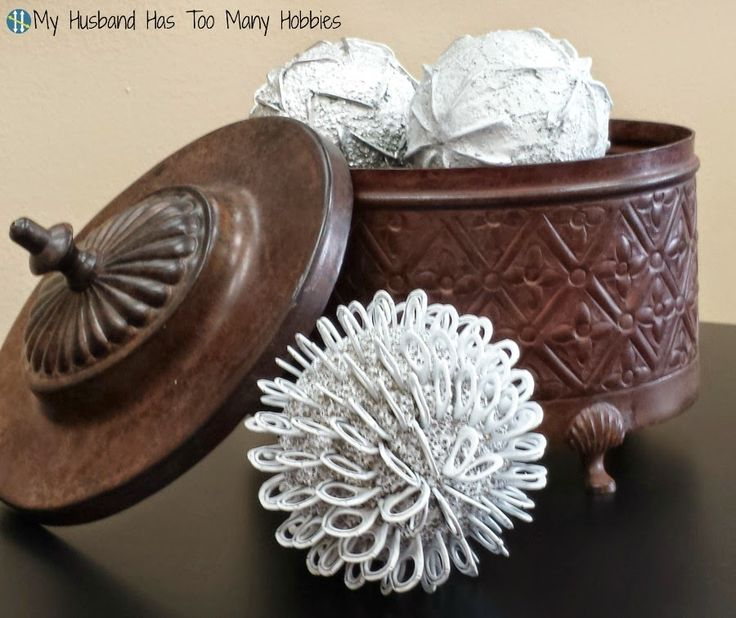 Pull tabs, styrofoam balls and spraypaint are used to create decorative globes for home decor. #upcycle #homedecor #pulltabcrafts
