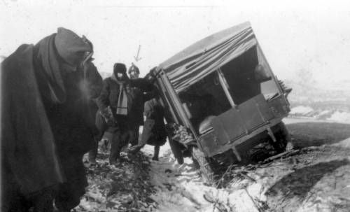 Mark Moody and others righting a toppled truck in Vladivostok. http://digitallibrary.usc.edu/cdm/ref/collection/p15799coll46/id/88