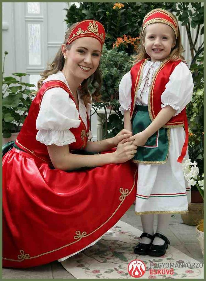 Díszmagyar in Hungary This red satin skirt and vest is the kind of costume my Mom had from Hungary.,,,it was DISZ (formal)...my Grandma said it was NOT country style dress!  We had a costume like this that my mother made.  All three of us wore it as we grew into it.