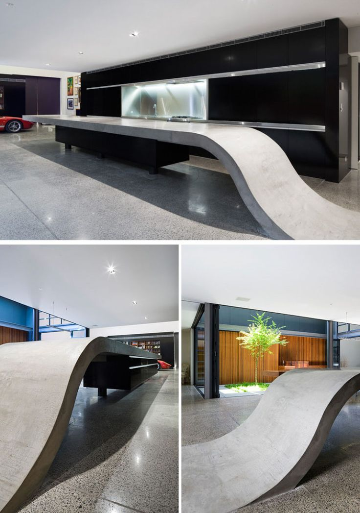 11 Creative Concrete Countertop Designs To Inspire You // The 9 meter long concrete countertop in the kitchen of this home rises up from the floor to create a sculptural kitchen island.