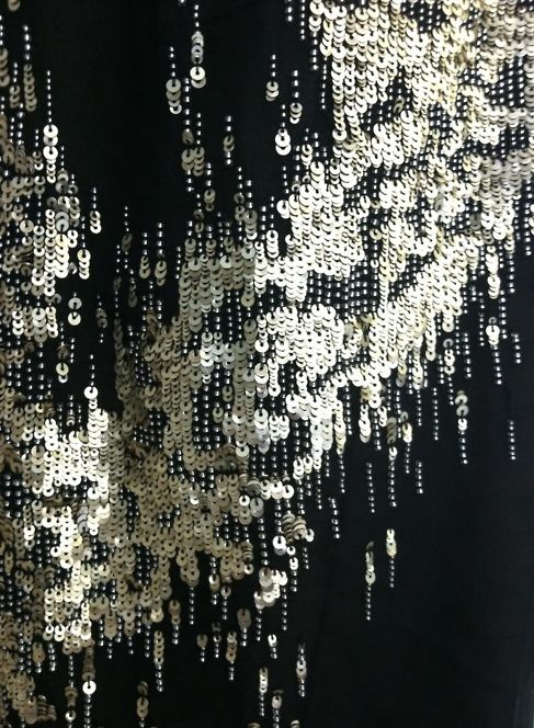 Nina Dobrev's #DonnaKaranAtelier gown embroidery up close. Metal sequins on silk chiffon. Heaven on a stick.