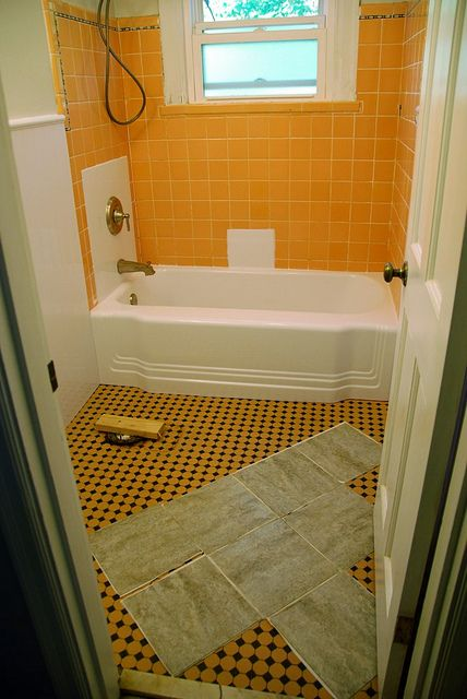 So, they had original midcentury modern mosaic tile flooring. Then, they stuck peel-and-stick grey tile over said original flooring. Then they grouted it. Then they went outside and poured all of their vintage scotches down the sewer drain because it's so much cooler to drink gin fizzes from mason jars. She knows because she saw it on Pinterest! (GAAHH I can't believe they did this.)