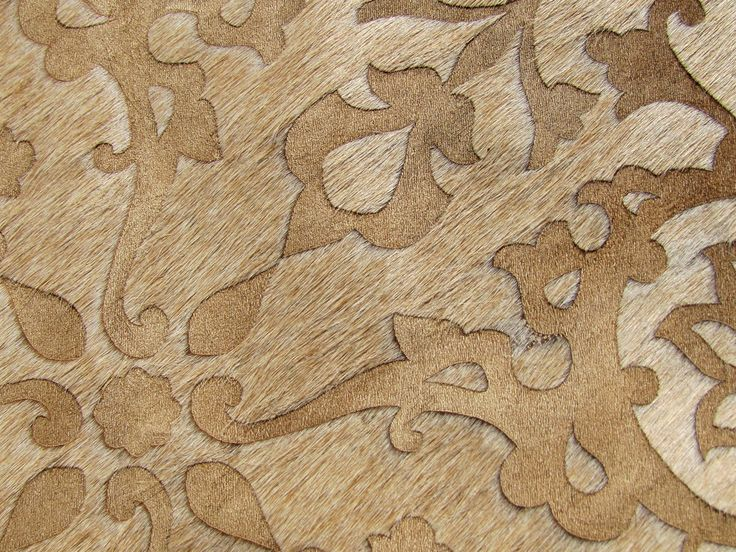 A close up of the opulent textures of Art Hide's Zirah in caramel. The Zirah is a beautiful, contemporary Asian-inspired floral motif design. For sizing, colour and purchasing information, see the Art Hide website.