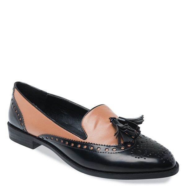 Black-brown loafer with patent details and decorative perforations and tassel.
