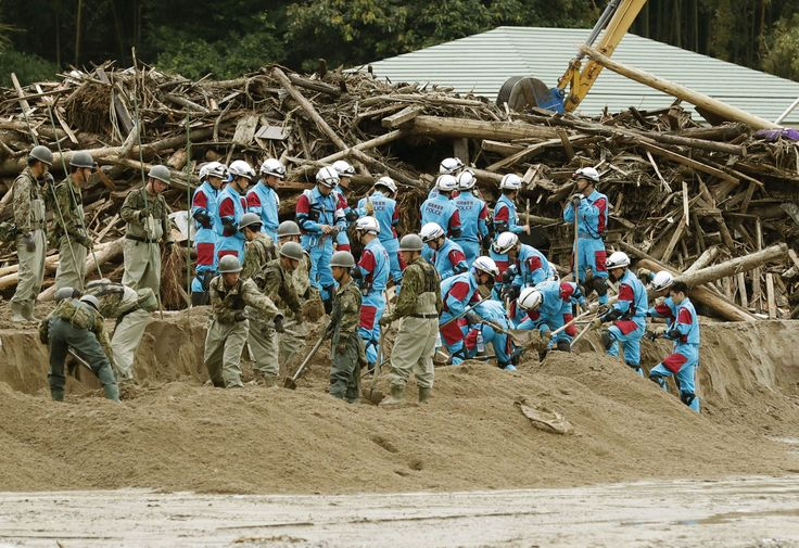 Japan leader Abe shortens Europe trip to visit flooded areas