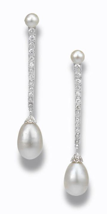 A pair of natural pearl and diamond pendant earrings Each set with a very light yellow natural pearl measuring approximately 10.3 x 15.2mm and 10.0-10.5 x 14.0mm, to a line of graduated brilliant and single-cut diamonds, to a very light yellow natural pearl measuring approximately 5.5-5.7 x 4.9mm and 5.7 x 5.1mm, mounted in platinum,