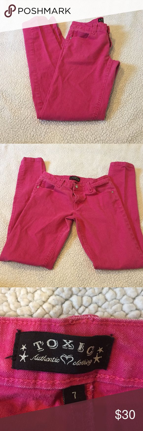 """Toxic hot pink skinny jeans Overall guc, they are somewhat faded and have minor pilling. Waist measures 13"""" and they do have a small amount of stretch. Inseam measures 30"""" Toxic Jeans Skinny"""