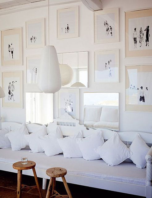 I'd love to do a similar collection of framed images, especially on a cobalt blue wall. Or a gray-ish dark blue. (Photo via The Style Files)