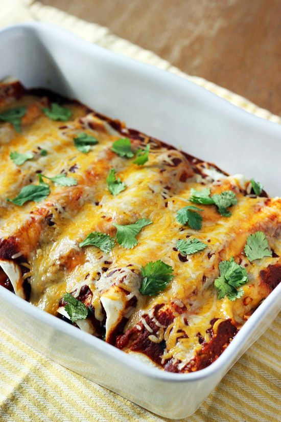 Black Bean, Spinach, and Corn Enchiladas are a delicious and quick vegetarian meal. They're packed with flavor and even meat-lovers love them!