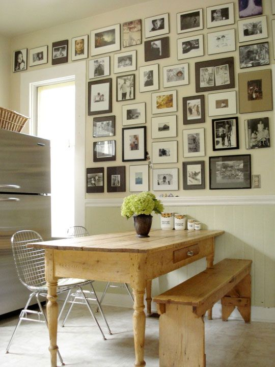 Photos of family covering a whole wall.  I'm not sure you would be able to see the top pics.  But a collection of family photos is special.   When can I get to IKEA to buy a boatload of frames?