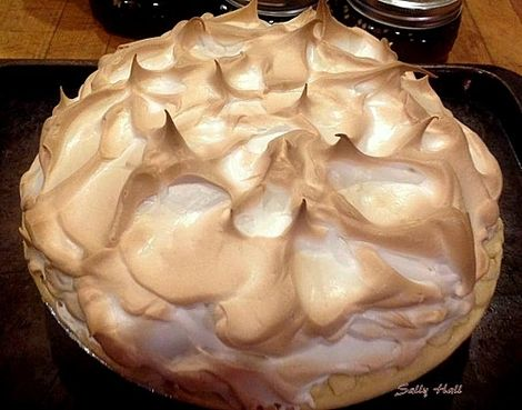Chocolate Meringue Pie. What a sight to behold! This is a real show stopper of a dessert fit for any dinner table and easy to make too! Lovefoodies