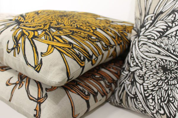Cushions with hand-printed #textile covers by Guild member and artist designer Sam Pickard.