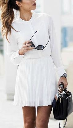 white total look with black leather handbag.
