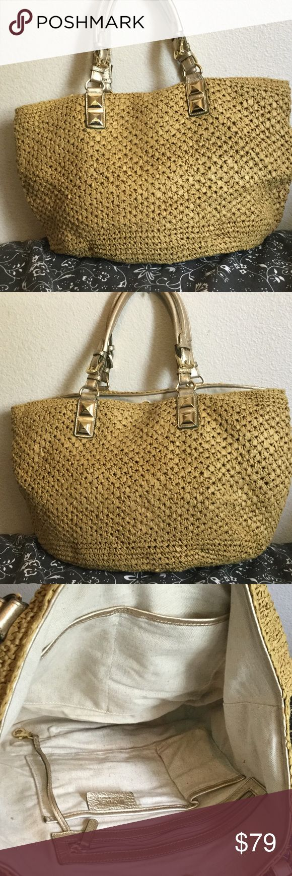 """Michael Kors MK SANTORINI straw tote MICHAEL KORS """"MK"""" SANTORINI Woven Straw Large """"Beach Bag"""" or Shopper Market Tote Bag.  Gold leather trim with gold tone hardware, large single interior compartment with signature canvas """"MK"""" fabric lining and slip and zipper pocket. This bag is in """"Good Condition"""" with some signs of wear. Size Large 20"""" widest  7.75 depth 12"""" tall KORS Michael Kors Bags Shoulder Bags"""