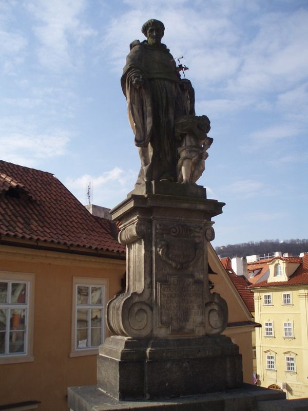 Photos of Charles Bridge South Side Statues: Statue of St. Nicholas of Tolentino on Charles Bridge